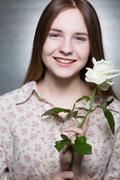 Girl with a white rose Stock Photos