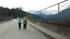 Two Women Walk On Cleveland Dam Road North Vancouver Canada Stock Footage