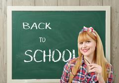 Back to school, pretty teacher with black glasses Kuvituskuvat