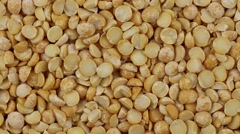 Yellow peas close up.   Front of the camera rotates plate with yellow peas Stock Footage