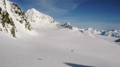 Alaskan Ski Plane Passes in Scenic Alpine Alaska Aerial Stock Footage