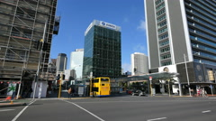 New Zealand Auckland street with yellow bus Stock Footage