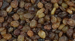 Raisins close up.   Front of the camera rotates plate with raisins Stock Footage