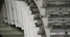Tomorrow's newspapers are printed on a high speed printing press. Stock Footage