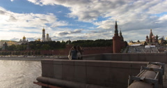 Young people take pictures af each other and selfies on vantage point on bridge Stock Footage