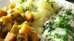 Healthy plate of nutritious food. Potatoes fish and veggie Stock Footage