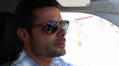 Handsome man driving casually. Relaxed driver on highway. Person on holidays Stock Footage