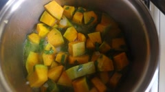 Cooking pumpkin inside pan Stock Footage