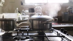 Steam coming out of pan Stock Footage