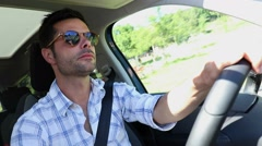 Handsome man driving casually. Relaxed driver on highway.  Stock Footage
