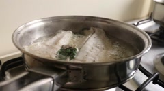 Cooking fish. Revealing fish Stock Footage