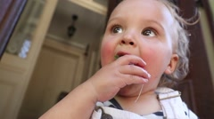 Baby grabbing strawberry fruit to eat. One year old toddler baby boy stuffing st Stock Footage