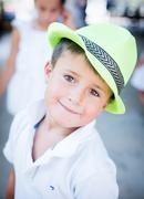 Cute boy in a hat on a background of nature Stock Photos