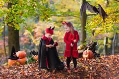 Kids on Halloween trick or treat Stock Photos