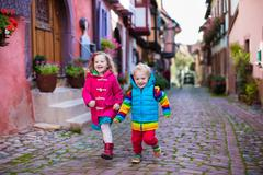 Children in historical city center in France Stock Photos