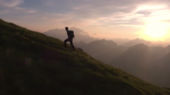 Aerial - Epic shot of a man hiking on the edge of the mountain Stock Footage