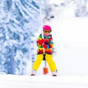 Child on ski lift Stock Photos