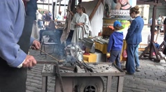 Reconstruction work of a blacksmith in the town festival, Riga, Latvia Stock Footage