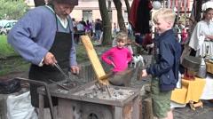 The boy helps the blacksmith at work, Riga, Latvia Stock Footage
