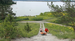 Russia, Siberia 2014: Men carry a rubber boat in the mountain. Tourists Stock Footage