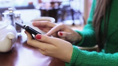 Woman using smartphone in a cafe, writing a message on the social network. Stock Footage