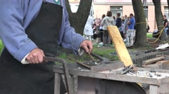 Blacksmith at work in the town festival, Riga, Latvia Stock Footage