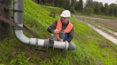 Engineer checking the pipe and walking away in 4k Stock Footage
