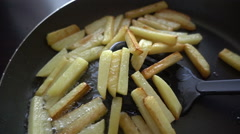 Potatoes fried in a pan Stock Footage