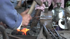 Blacksmith at work in the town festival, close-up, Riga, Latvia Stock Footage