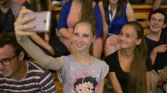 Girls Students make Selfie Photo Mobile Phone on the School Hall Stands Stock Footage