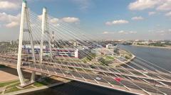 Vehicles drive on ringway. The Big (Bolshoy) Obukhovsky cable-stayed bridge Stock Footage