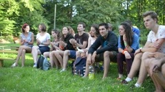 Young Catholic sing and clap their hands at a picnic nature Stock Footage