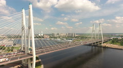 Cable-stayed Bolshoy Obukhovsky Bridge with city road. Neva riv, St. Petersburg Stock Footage