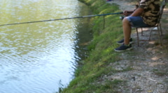Beautiful views of forest lake with reflection. Fisherman with a fishing rod Stock Footage