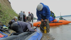 Russia, Siberia 2014: The boat is inflated pump. Inflatable boat Stock Footage