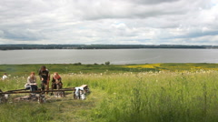 Russia, Siberia 2014: Tourists near the fire, the river behind Stock Footage