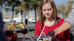 Service at street. Waiter brings snacks to young female Stock Footage