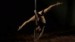 Professional Pole Dance. Young beautiful woman shows elements. Montage. Stock Footage
