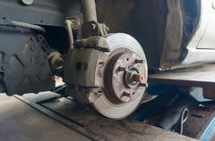 Rusty Front Car Wheel Hub with Disk Brake System - stock photo