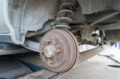 Rusty Rear Car Wheel Hub with Drum Brake System and Suspension Stock Photos