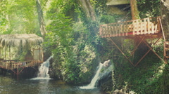 Bungalow by the river with small waterfalls. Dymchay - rest in Turkey, Alanya Stock Footage