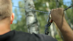 Rope park. Hand rope, carabiner. Adventure park in forests - stock footage