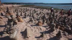 People in a beach Zen Garden stones - Vila Nova Mil Fontes Portugal Stock Footage
