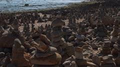 Zen Garden stones at beach - Vila Nova Mil Fontes Portugal Stock Footage