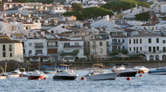 Anchored Boats in Front of a Mediterranean Village Stock Footage