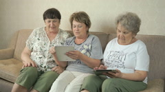 Elderly women holding digital tablets at home Stock Footage