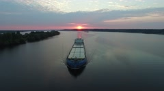 A barge floating in the river at dawn. Aerial view. Stock Footage