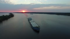 A barge floating in the river at sunrise. Aerial view. Stock Footage