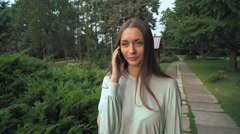 The girl is on track and talking on the phone Stock Footage