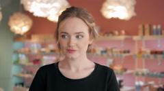 Portrait of beautiful shopaholic sexy woman inside a store Stock Footage